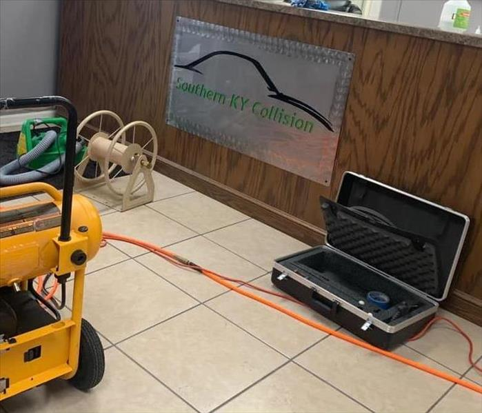 Floor and front desk of an office covered with different cleaning equipment